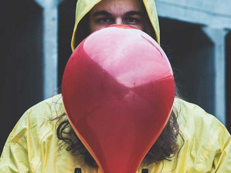 red balloon yellow raincoat