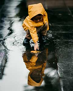 kid in yellow raincoat