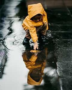 kid in yellow raincoat